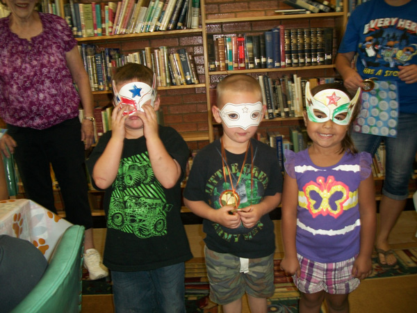 summer reading kids in hand-made super hero masks